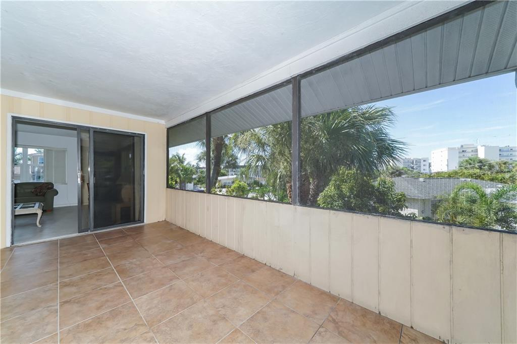 First floor second bedroom - Single Family Home for sale at 5591 Cape Aqua Dr, Sarasota, FL 34242 - MLS Number is A4411099
