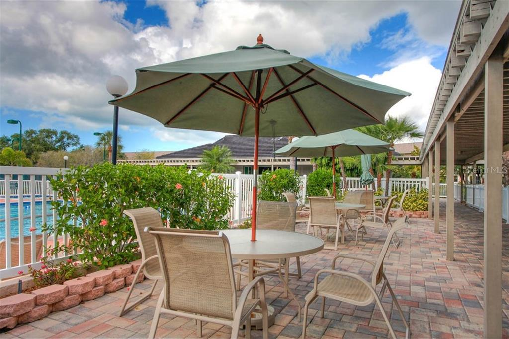 Meet with friends at the Club; an inviting patio outside. - Condo for sale at 1716 Starling Dr #204, Sarasota, FL 34231 - MLS Number is A4412237