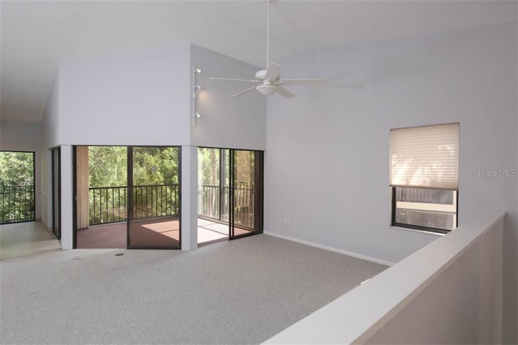 Enjoy and open floor plan complete w/treetop views - Condo for sale at 1716 Starling Dr #204, Sarasota, FL 34231 - MLS Number is A4412237