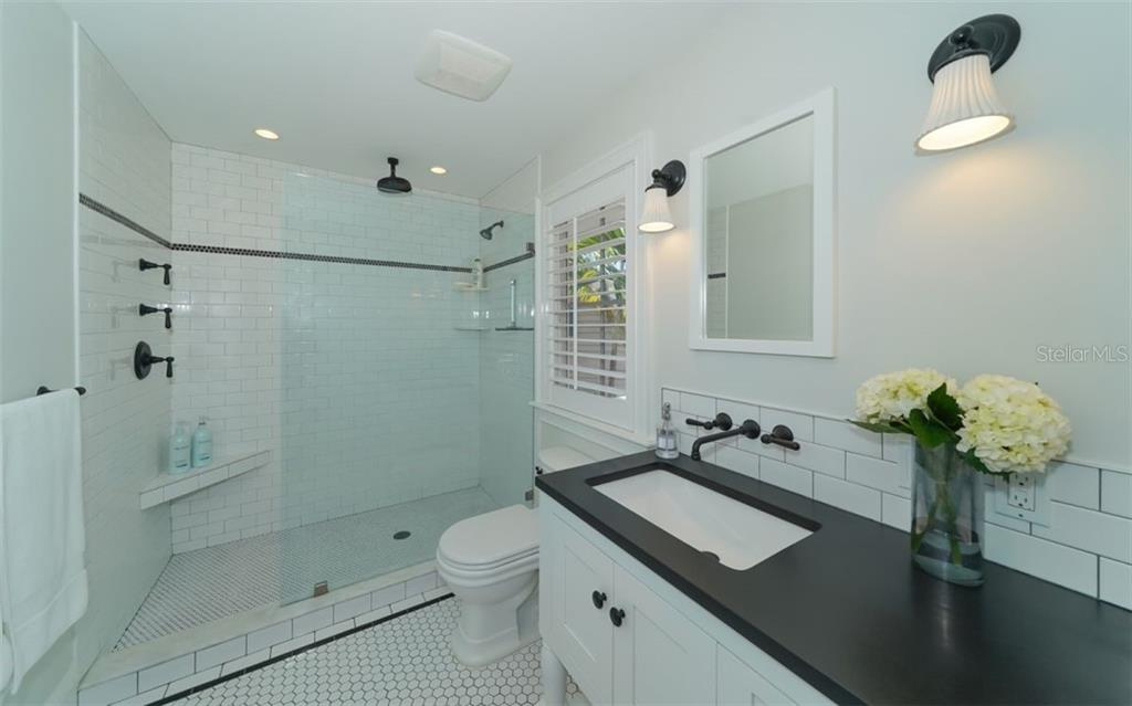 The Master Bath features hexagonal marble flooring and Subway tile in the shower and backsplash - Single Family Home for sale at 138 Island Cir, Sarasota, FL 34242 - MLS Number is A4412265