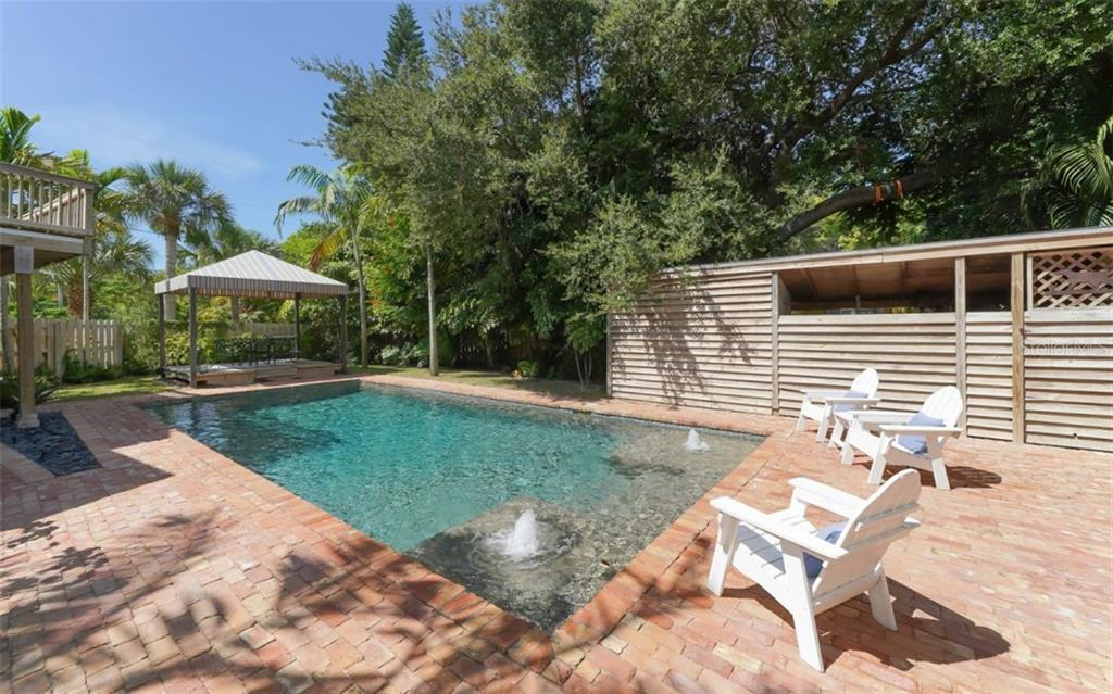 Alternate view of the Cabana - The huge saltwater pool is 9 feet deep! - Single Family Home for sale at 138 Island Cir, Sarasota, FL 34242 - MLS Number is A4412265