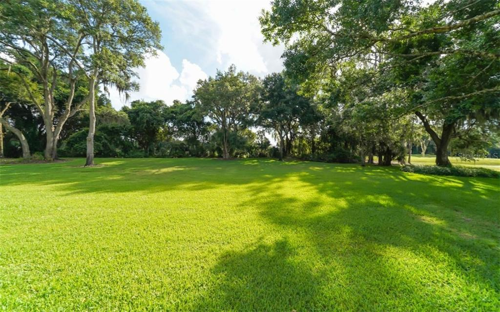 Backyard with golf course fairway off to far right - Single Family Home for sale at 3183 Dick Wilson Dr, Sarasota, FL 34240 - MLS Number is A4412326