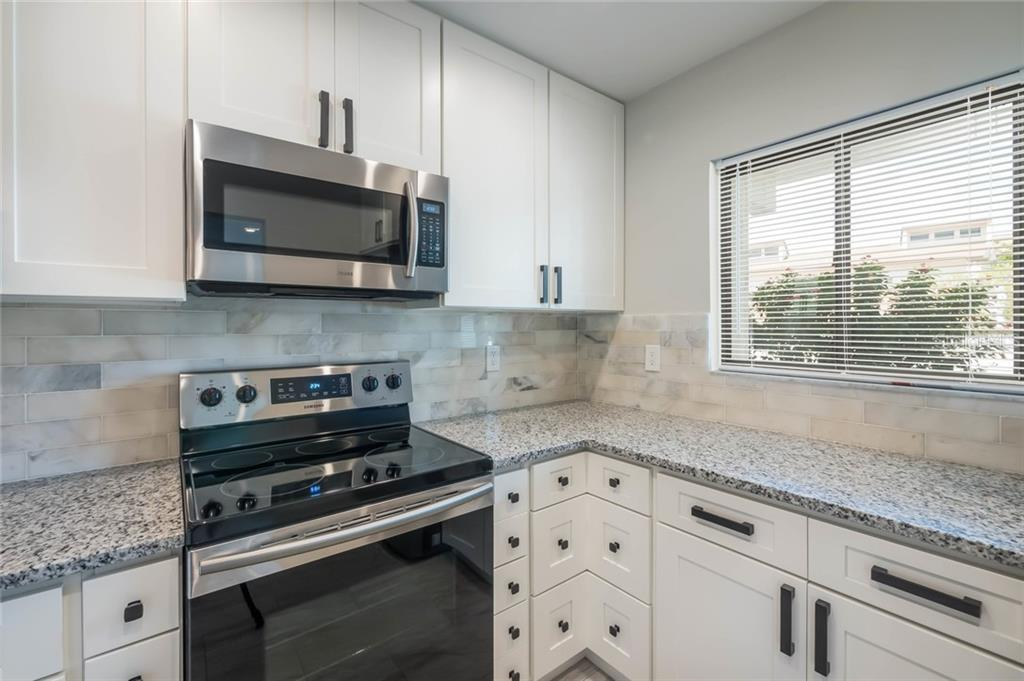 Kitchen - Condo for sale at 826 Bird Bay Way #112, Venice, FL 34285 - MLS Number is A4413103