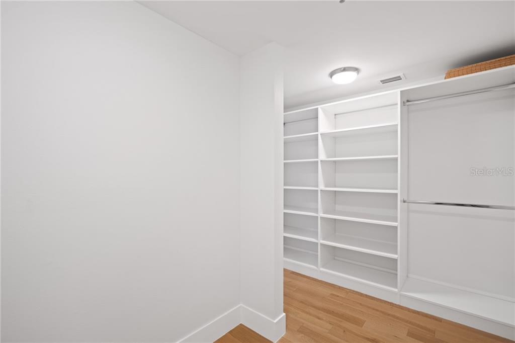 Guest/2nd Master walk-in closet with built in shelving. - Condo for sale at 1255 N Gulfstream Ave #1502, Sarasota, FL 34236 - MLS Number is A4413205