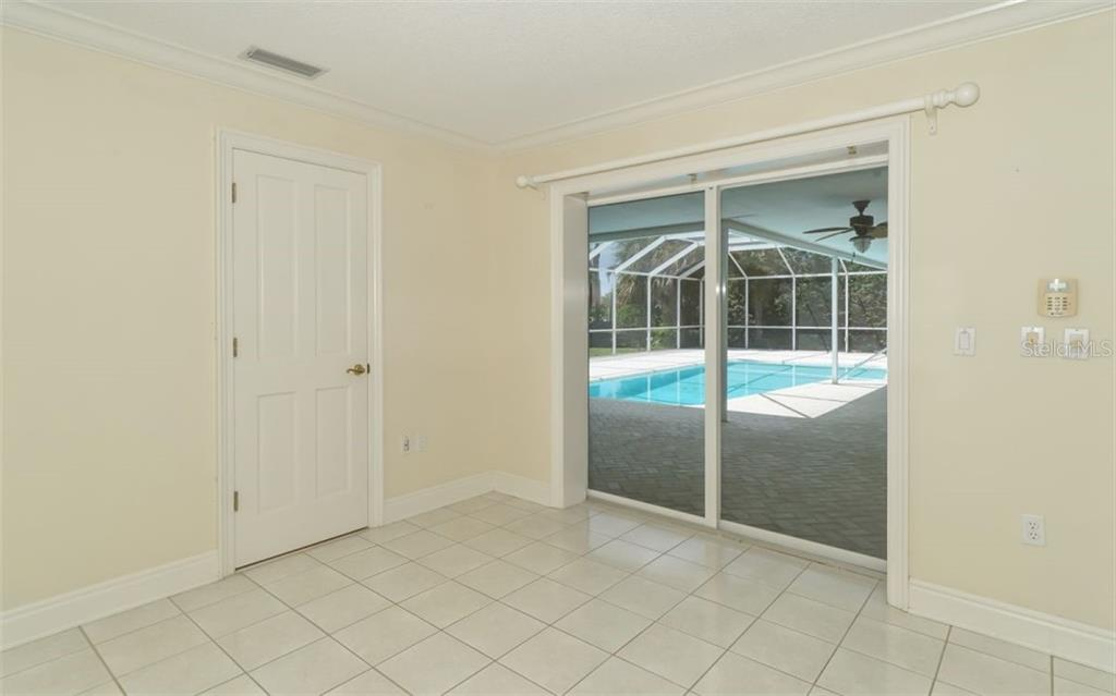 View out to the patio and pool from the master bedroom. - Single Family Home for sale at 390 Bob White Dr, Sarasota, FL 34236 - MLS Number is A4413388
