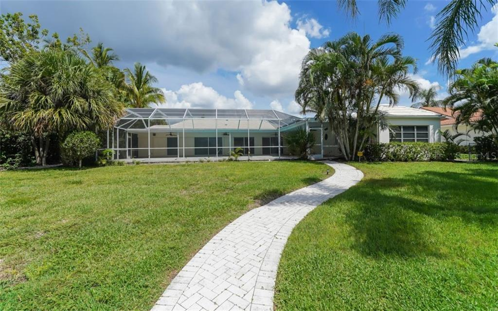 Meander on back to the house after a day on the water!. - Single Family Home for sale at 390 Bob White Dr, Sarasota, FL 34236 - MLS Number is A4413388