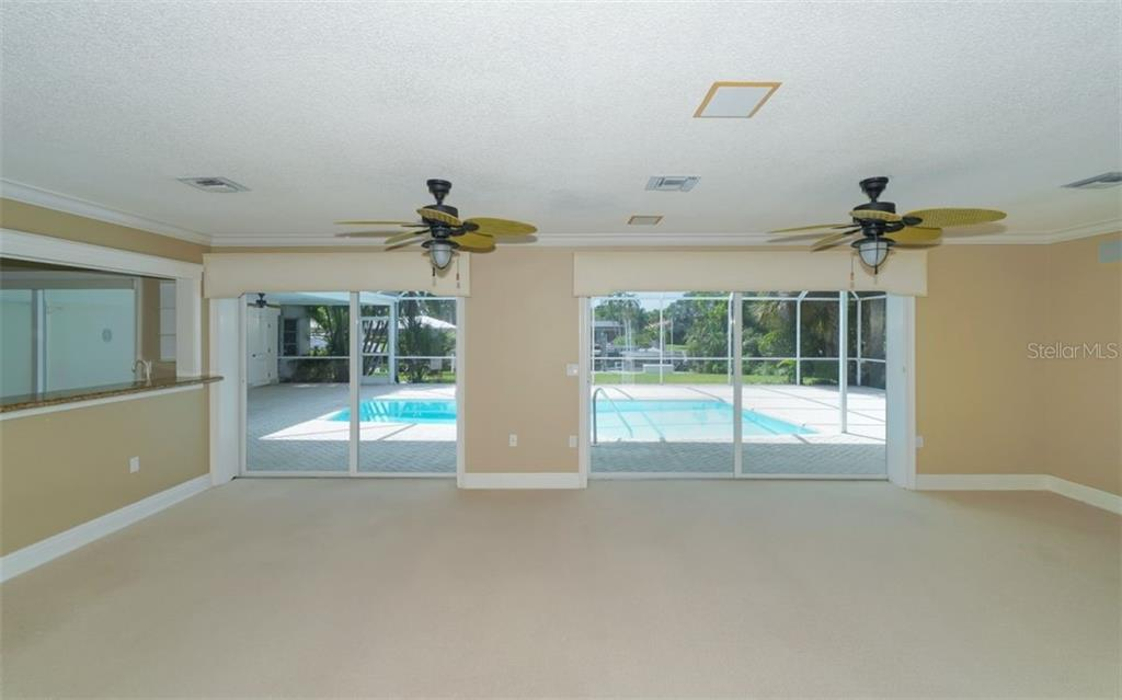Come in the front door to this view! Nice end of the day treat! - Single Family Home for sale at 390 Bob White Dr, Sarasota, FL 34236 - MLS Number is A4413388