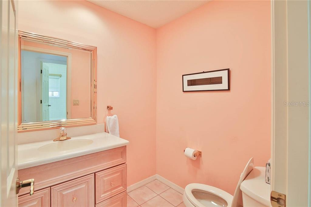 Powder Room - Villa for sale at 7686 Calle Facil, Sarasota, FL 34238 - MLS Number is A4413755