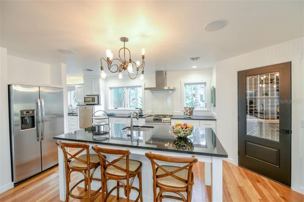Open kitchen with your private wine cellar. - Single Family Home for sale at 550 Ohio Pl, Sarasota, FL 34236 - MLS Number is A4414310