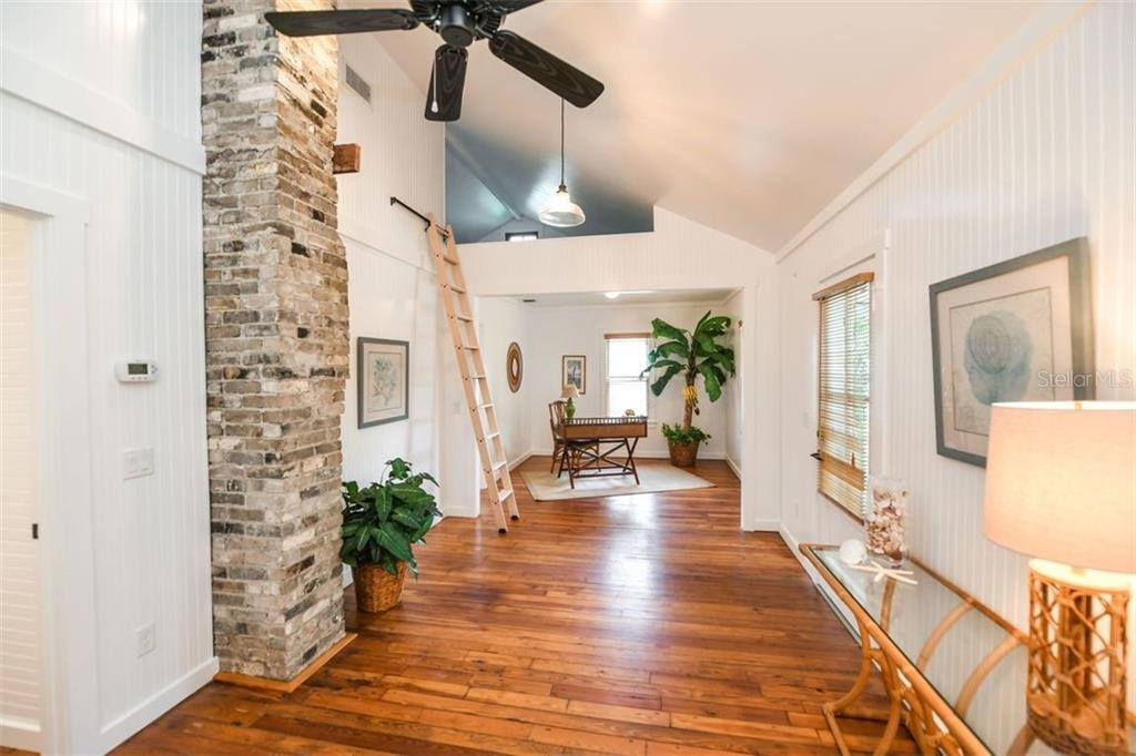 Open space with vaulted ceilings and a reading loft. - Single Family Home for sale at 550 Ohio Pl, Sarasota, FL 34236 - MLS Number is A4414310