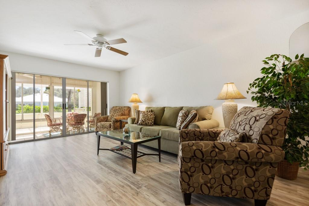 Spacious lanai with sliders from the living room - Condo for sale at 446 Cerromar Rd #193, Venice, FL 34293 - MLS Number is A4414683