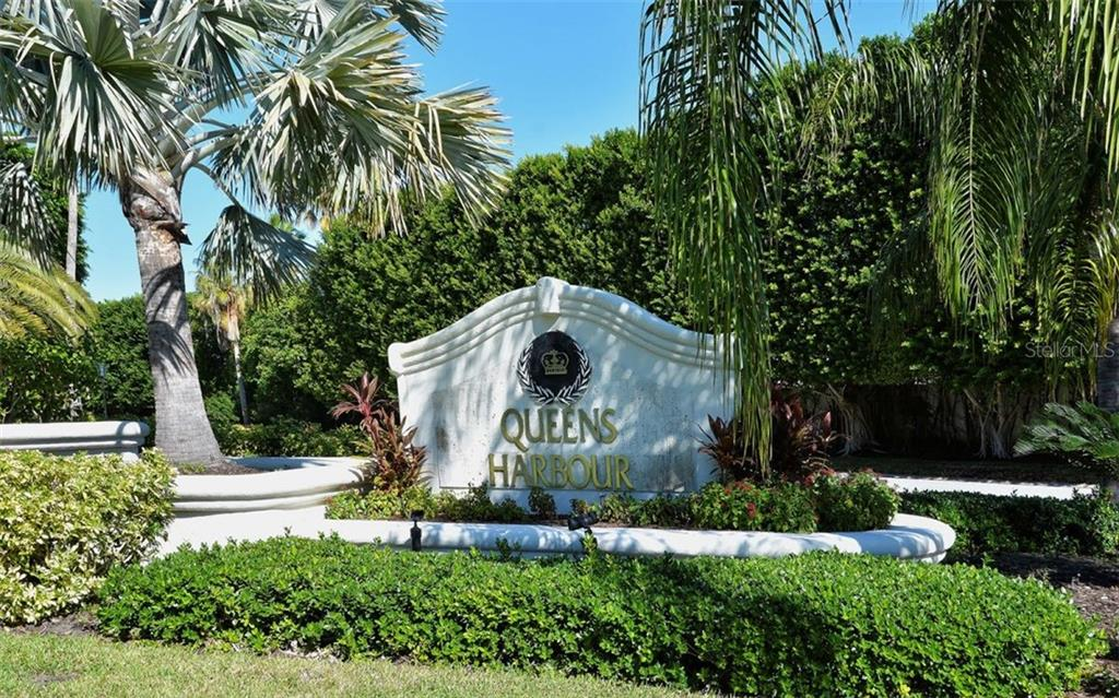 Entrance to the maintenance free community of Queens Harbour - Single Family Home for sale at 3529 Fair Oaks Ln, Longboat Key, FL 34228 - MLS Number is A4414992