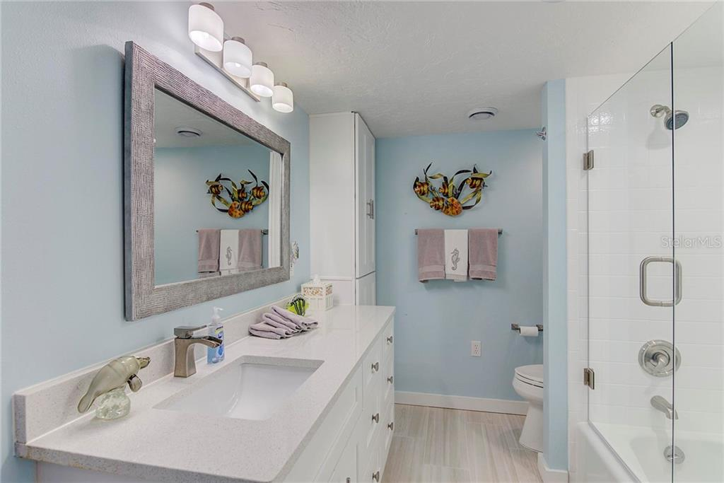 Guest Bath - Condo for sale at 8750 Midnight Pass Rd #502c, Siesta Key, FL 34242 - MLS Number is A4416020