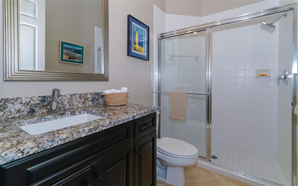 First Level Guest Bath - Single Family Home for sale at 7698 Albert Tillinghast Dr, Sarasota, FL 34240 - MLS Number is A4416123