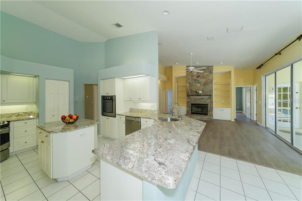 Rich granite counters compliment the stainless appliances - Single Family Home for sale at 1714 79th Ct W, Bradenton, FL 34209 - MLS Number is A4416601