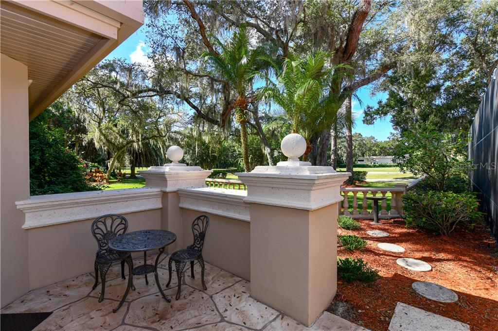 Guest House Courtyard - Single Family Home for sale at 7659 Alister Mackenzie Dr, Sarasota, FL 34240 - MLS Number is A4416607