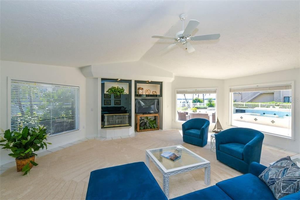 Stunning Family room, wood burning fireplace. This would also make an incredible first level Master Suite. - Single Family Home for sale at 7689 Cove Ter, Sarasota, FL 34231 - MLS Number is A4417242