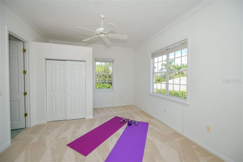 Upper level bedroom #4. - Single Family Home for sale at 7689 Cove Ter, Sarasota, FL 34231 - MLS Number is A4417242