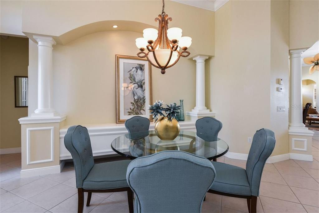 Dining Room with Built In Open to Living Room & Kitchen, Great for Entertaining - Single Family Home for sale at 7060 Whitemarsh Cir, Lakewood Ranch, FL 34202 - MLS Number is A4417363