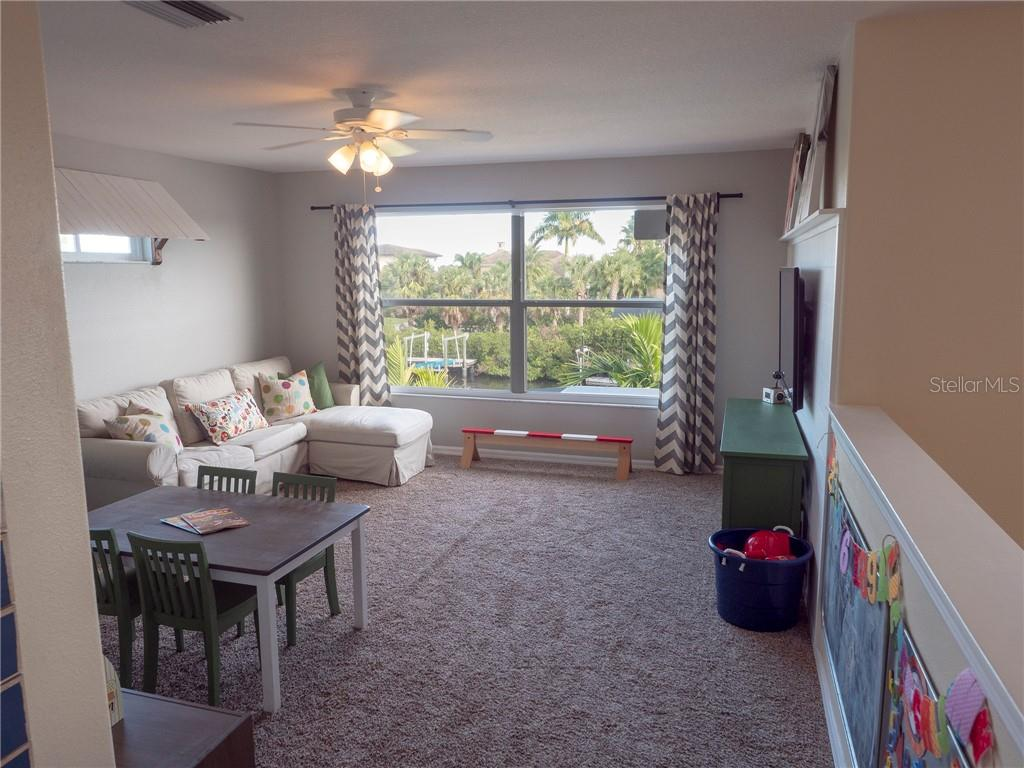 This is a spacious upstairs loft with incredible water views! Can be used as a large office, family room, workout room or playroom for the kids! - Single Family Home for sale at 3803 5th Ave Ne, Bradenton, FL 34208 - MLS Number is A4417524