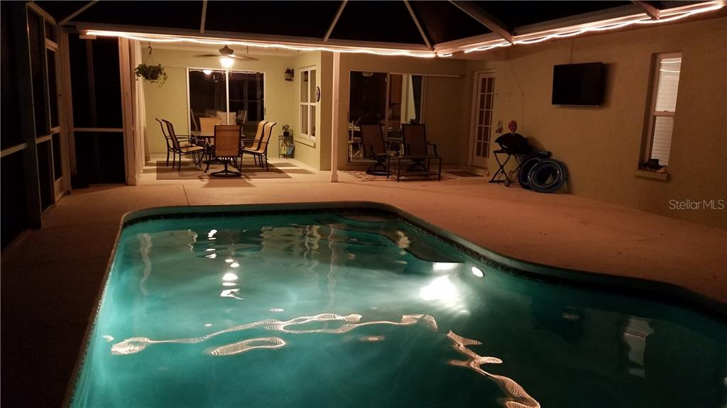 Night time beauty of private pool area. - Single Family Home for sale at 1611 82nd St Nw, Bradenton, FL 34209 - MLS Number is A4417607