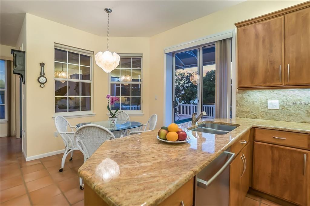 Open kitchen w/sliding glass door to pool - Single Family Home for sale at 4963 Oxford Dr, Sarasota, FL 34242 - MLS Number is A4417783
