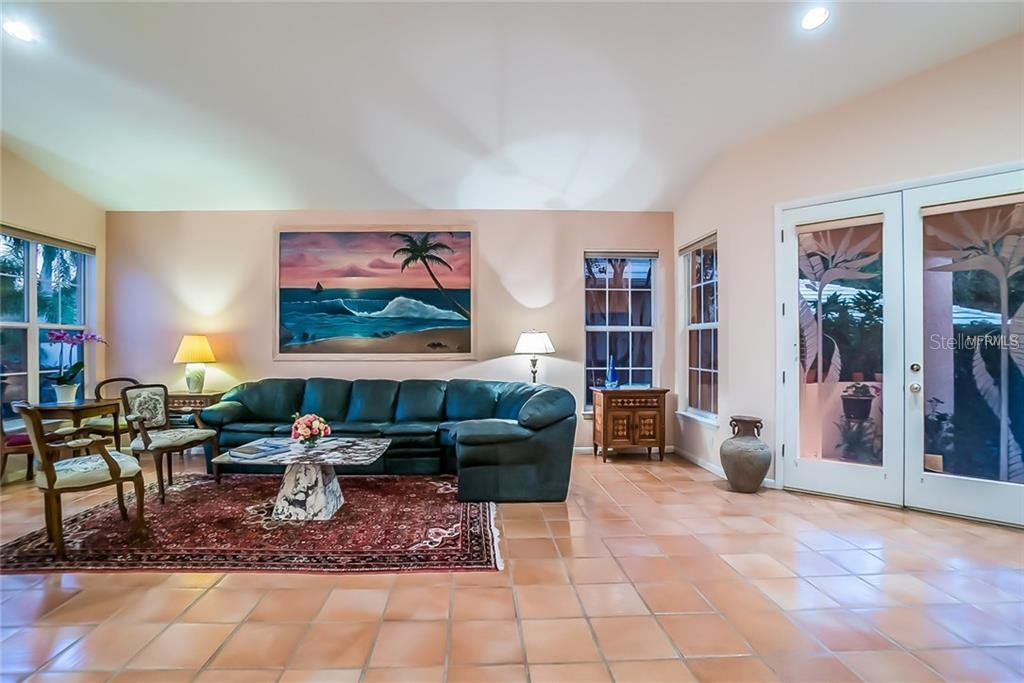 Spacious LR with Spanish tile floor - Single Family Home for sale at 4963 Oxford Dr, Sarasota, FL 34242 - MLS Number is A4417783