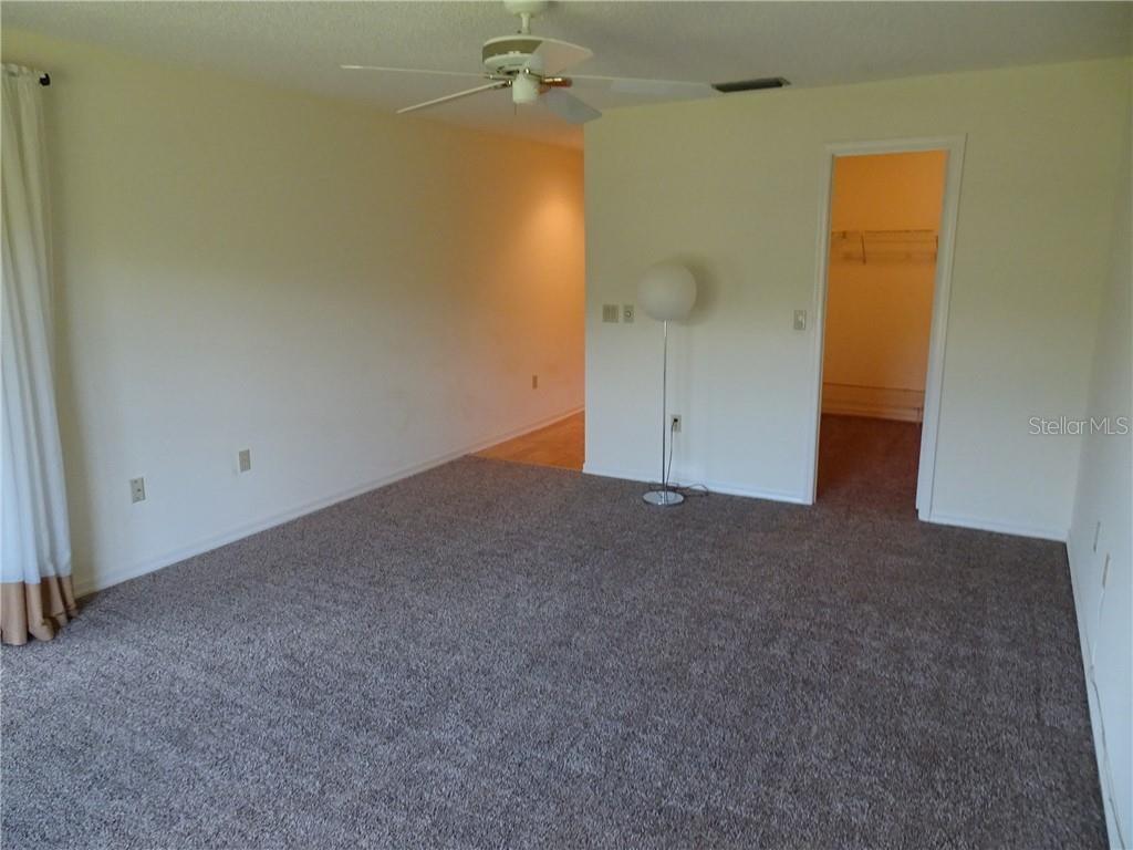 Spacious master bedroom with new carpet. - Villa for sale at 3617 Gleneagle Dr, Sarasota, FL 34238 - MLS Number is A4417832