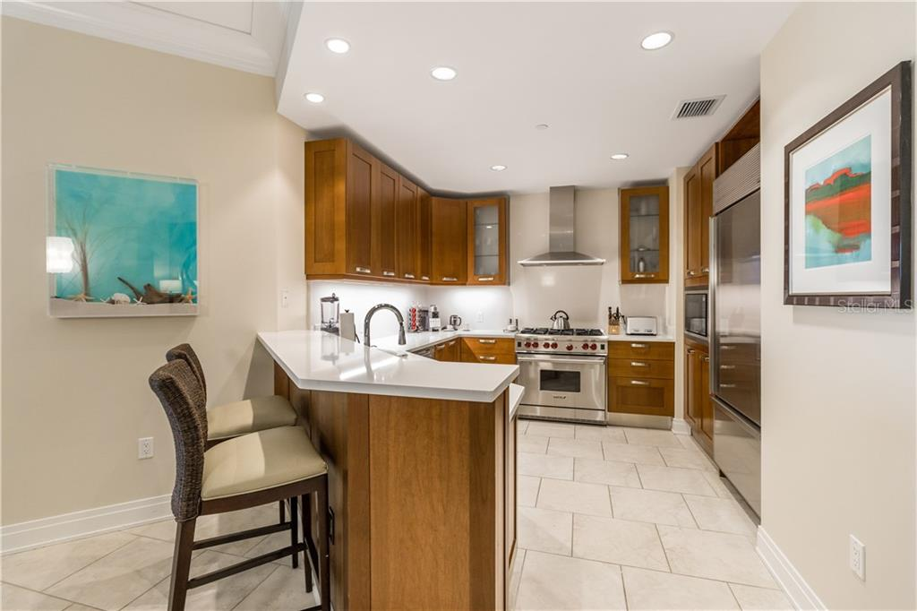 Sit and watch a private chef, arranged by concierge services, cook up a delicious meal for you. - Condo for sale at 915 Seaside Dr #610, Sarasota, FL 34242 - MLS Number is A4417976