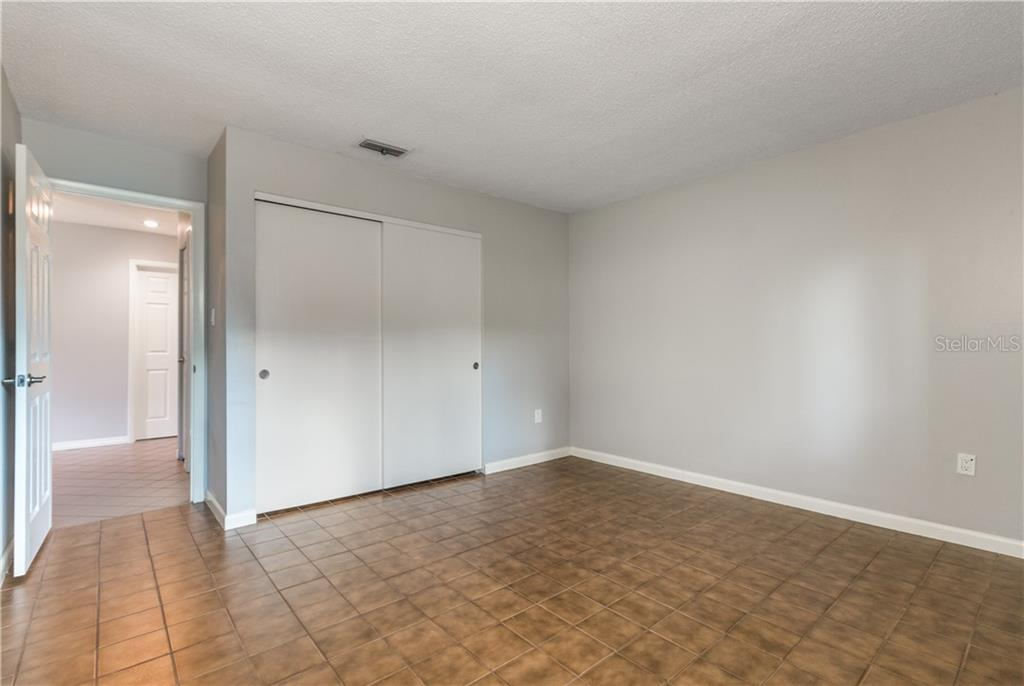 Second bedroom off entrance. - Villa for sale at 5235 Myrtle Wood #18, Sarasota, FL 34235 - MLS Number is A4418558