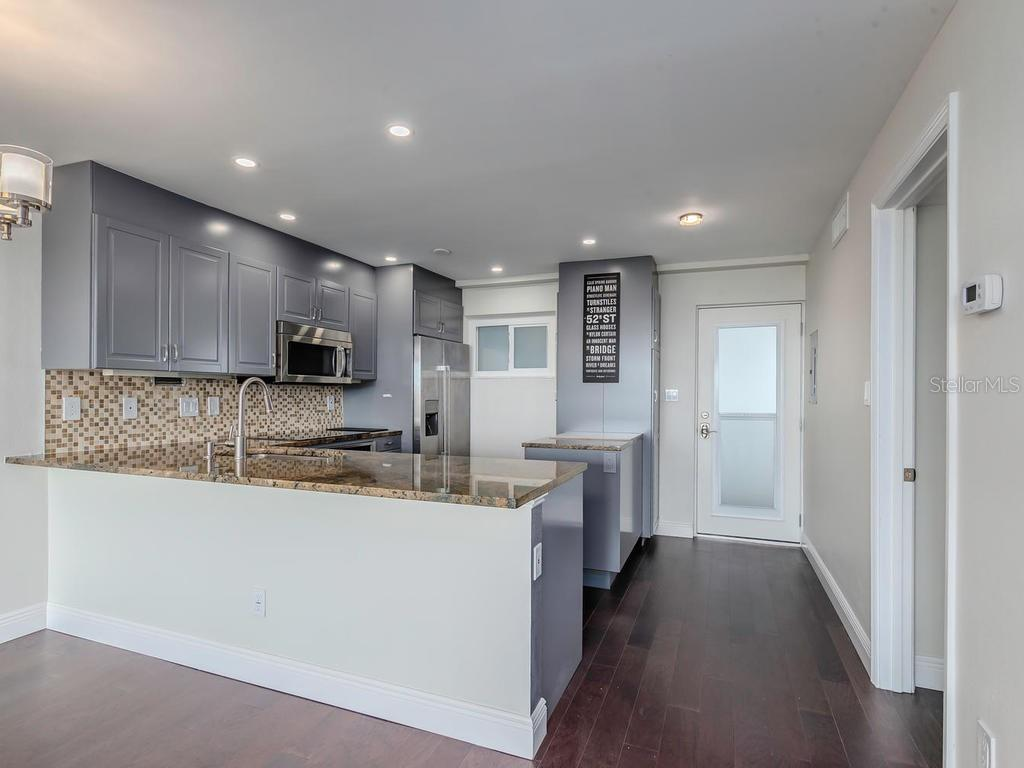 Open Kitchen and front door. - Condo for sale at 33 S Gulfstream Ave #706, Sarasota, FL 34236 - MLS Number is A4419314