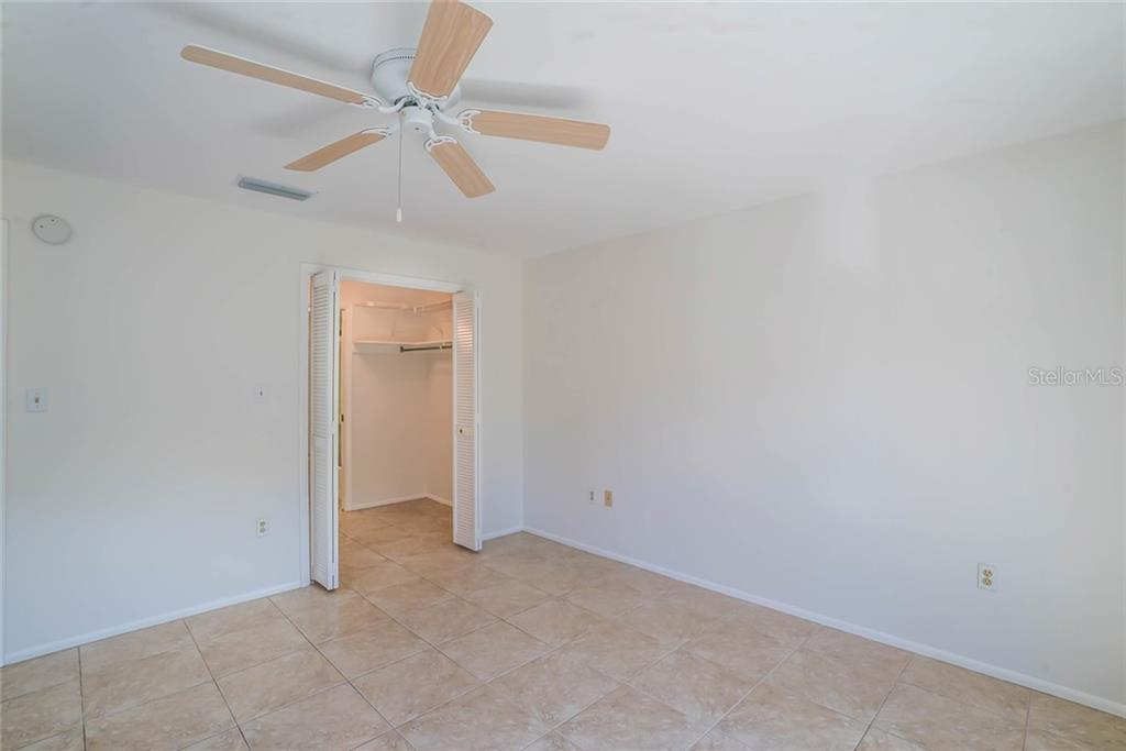 View from master bedroom into oversized walk in and walk through closet, gaining access to master bathroom.  Ample storage! - Condo for sale at 600 Manatee Ave #202, Holmes Beach, FL 34217 - MLS Number is A4419465