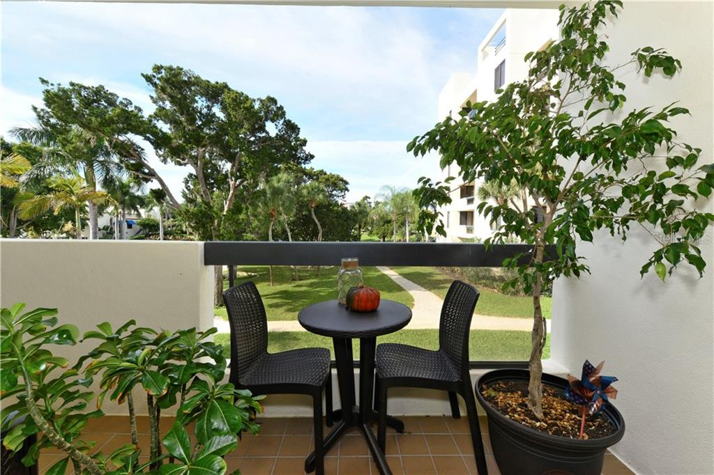 Second terrace off the kitchen and dining area - Condo for sale at 1930 Harbourside Dr #117, Longboat Key, FL 34228 - MLS Number is A4420232
