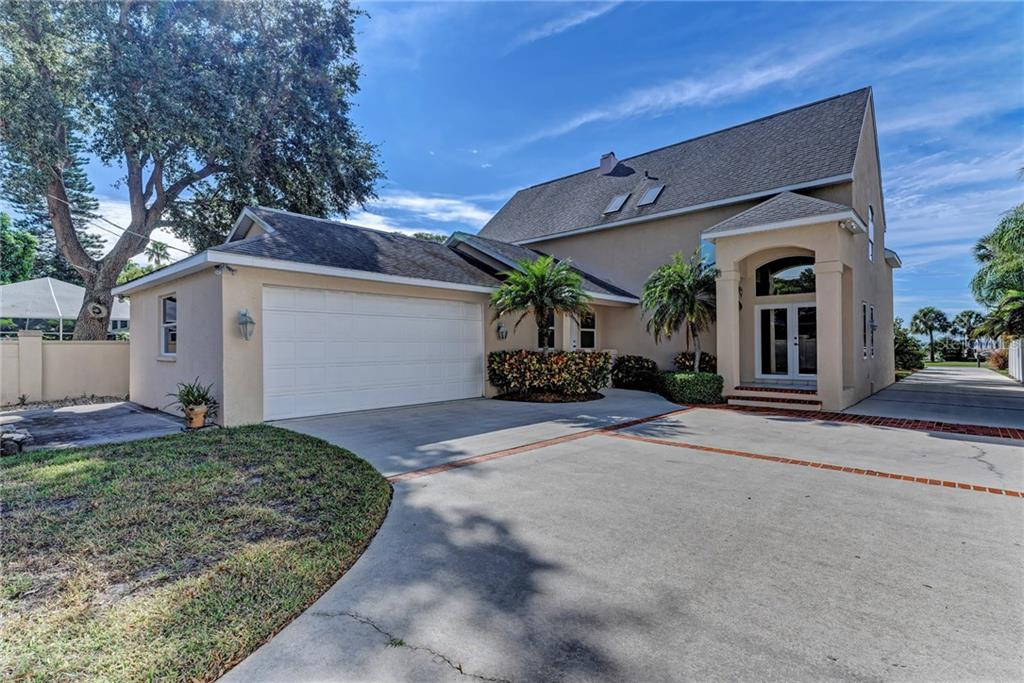 MAIN ENTRANCE & OVERSIZED GARAGE - Single Family Home for sale at 5110 Sun Cir, Sarasota, FL 34234 - MLS Number is A4420424