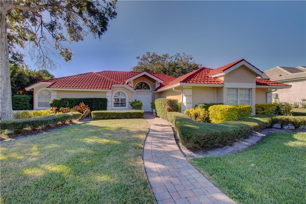 Front view of the home - Single Family Home for sale at 5167 Kestral Park Ln, Sarasota, FL 34231 - MLS Number is A4421162