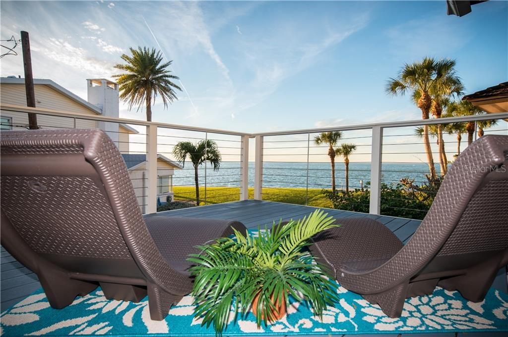 Relaxing deck with view of Gulf of Mexico. - Single Family Home for sale at 108 Sand Dollar Ln, Sarasota, FL 34242 - MLS Number is A4421218