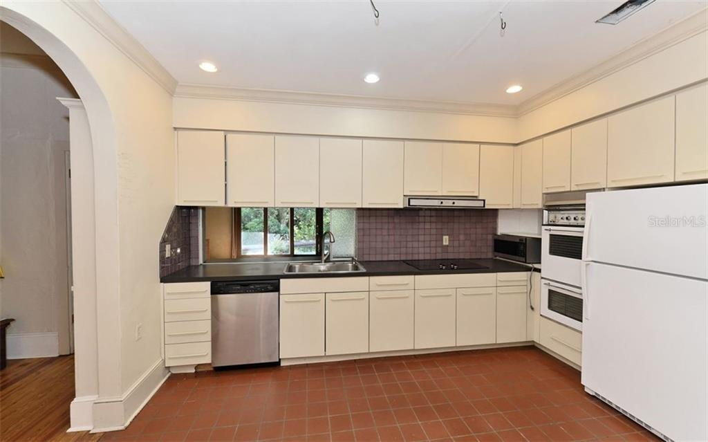 Kitchen with pass through to the family and direct access to the dining room. - Single Family Home for sale at 2262 Okobee Dr, Sarasota, FL 34239 - MLS Number is A4421275