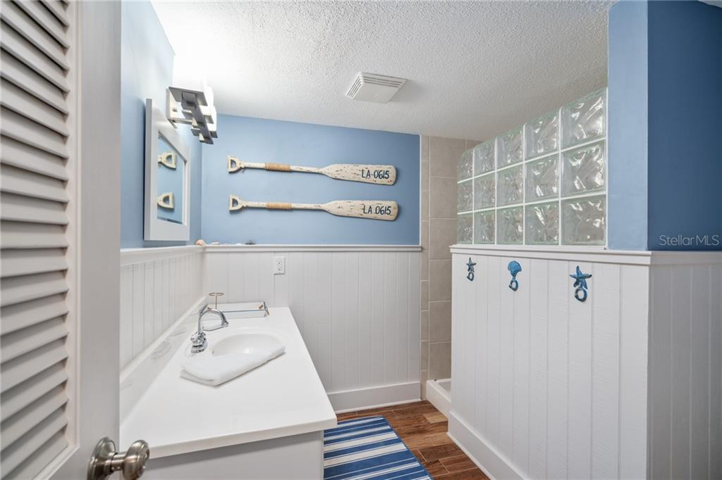 First Floor Guest Bath 3 - Single Family Home for sale at 107 Willow Ave, Anna Maria, FL 34216 - MLS Number is A4421946