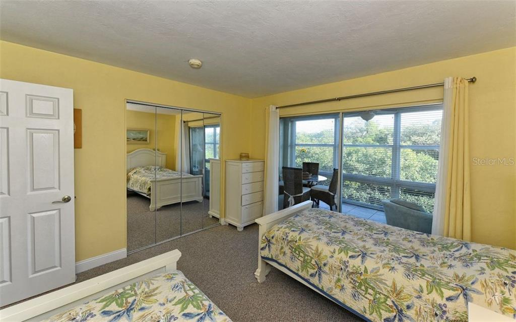 Guest bedroom - Condo for sale at 4540 Gulf Of Mexico Dr #201, Longboat Key, FL 34228 - MLS Number is A4422082