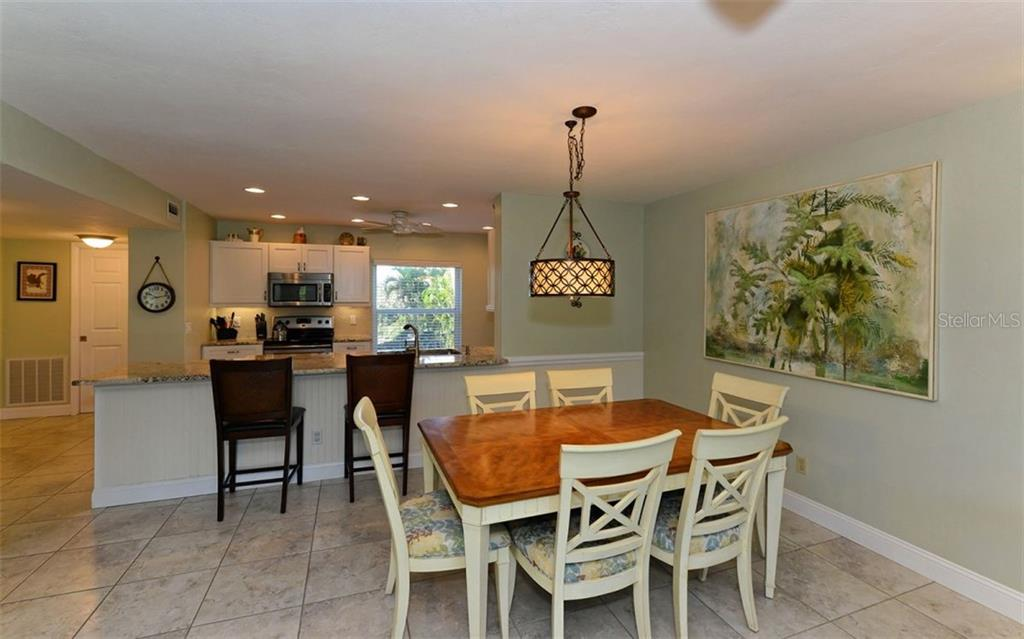 Kitchen has been renovated to allow for much more space and counter prep area. - Condo for sale at 4540 Gulf Of Mexico Dr #201, Longboat Key, FL 34228 - MLS Number is A4422082