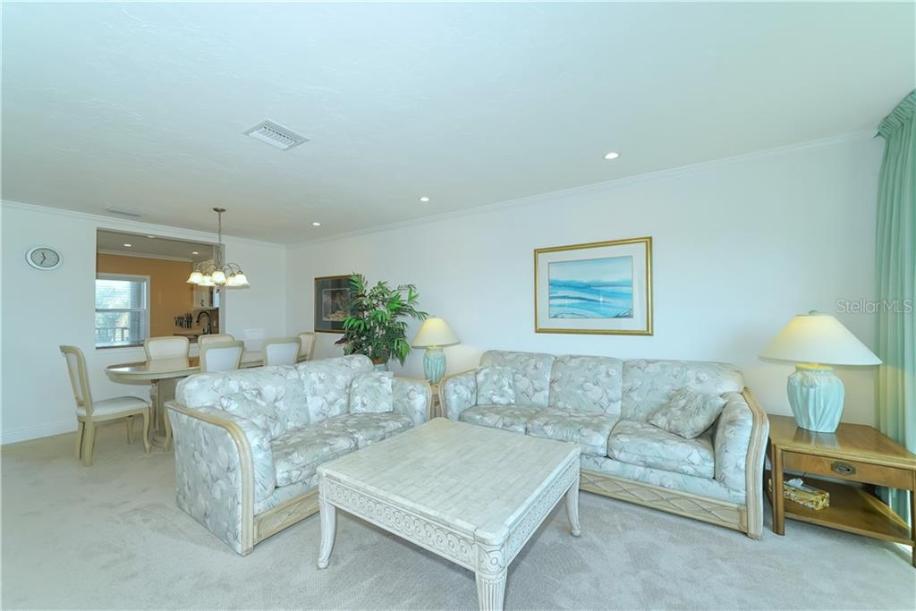 The kitchen has been renovated and opened up to join in with the living/dining great room...perfect for gatherings. - Condo for sale at 4700 Gulf Of Mexico Dr #305, Longboat Key, FL 34228 - MLS Number is A4422164