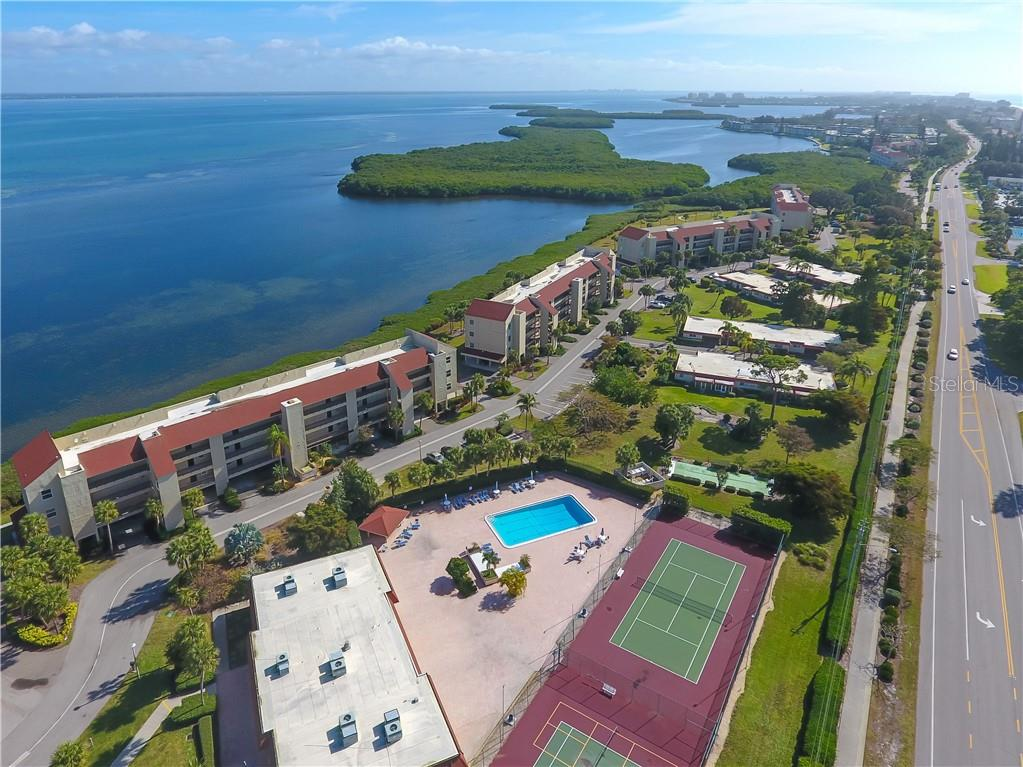 Windward Bay has two pools, complimentary chaises, tennis, pickle ball, shuffleboard and a clubhouse with catering kitchen. - Condo for sale at 4700 Gulf Of Mexico Dr #305, Longboat Key, FL 34228 - MLS Number is A4422164