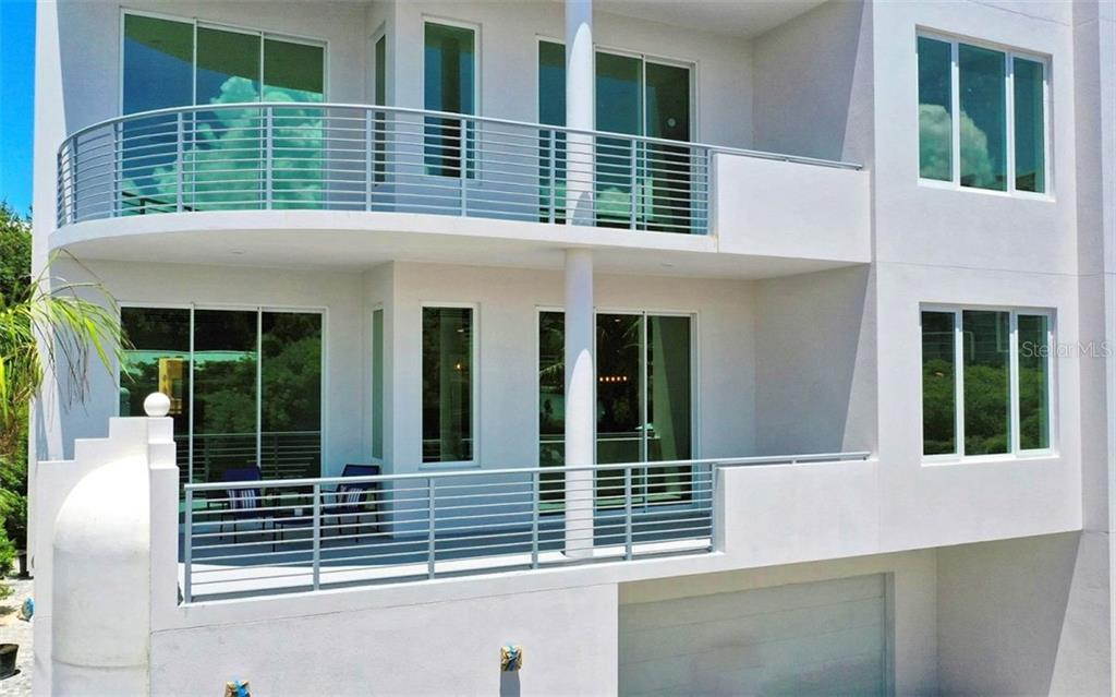 Enjoy the morning sun on the front terrace - one of three offered in Unit 201. - Condo for sale at 609 Golden Gate Pt #201, Sarasota, FL 34236 - MLS Number is A4422340