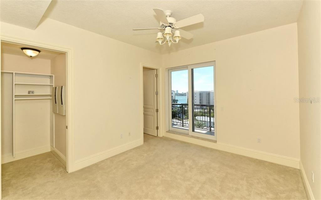 Guest En Suite #2 with bathroom and fitted closets. - Condo for sale at 464 Golden Gate Pt #701, Sarasota, FL 34236 - MLS Number is A4422622