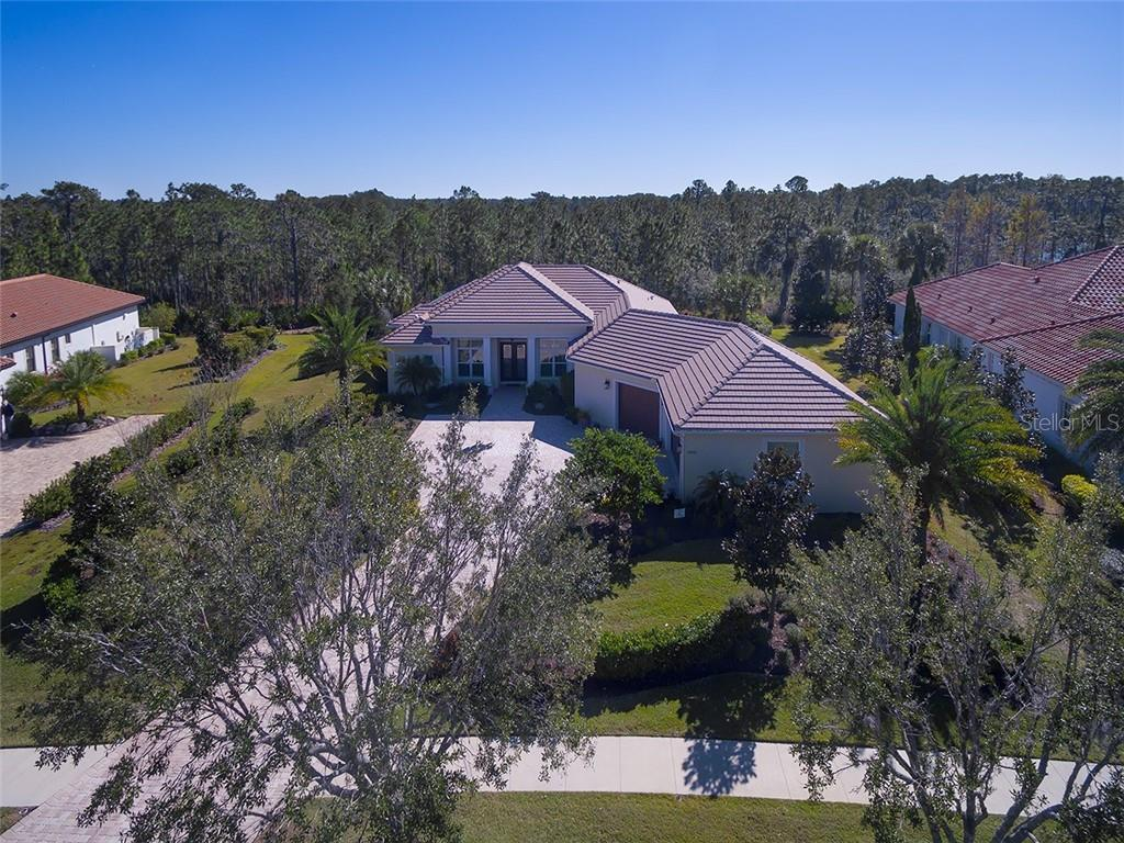 Lots of forested land surrounds this beautiful home. - Single Family Home for sale at 19452 Beacon Park Pl, Bradenton, FL 34202 - MLS Number is A4422948