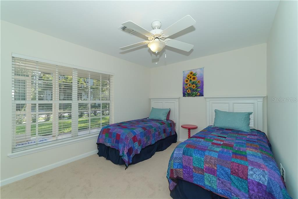 Bedroom 3, plenty of room! - Single Family Home for sale at 2300 Mietaw Dr, Sarasota, FL 34239 - MLS Number is A4423151