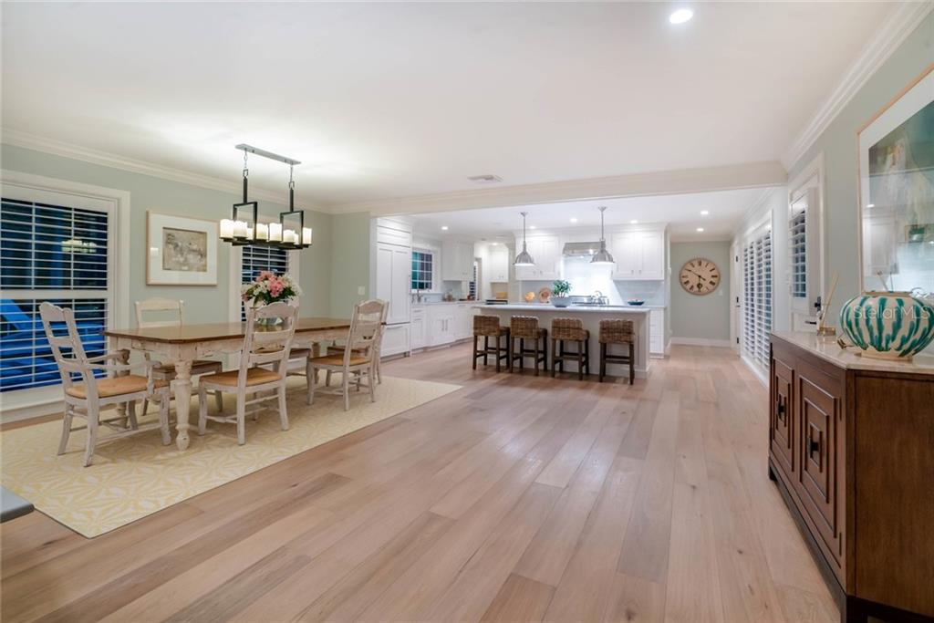 Open Living spaces with beautiful oak floors and plantation shutters throughout - Single Family Home for sale at 6957 Belgrave Dr, Sarasota, FL 34242 - MLS Number is A4423362