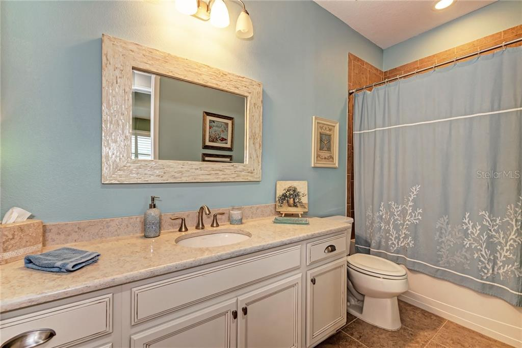 This spacious guest bathroom is shared by the two downstairs guest rooms. - Single Family Home for sale at 5260 Bentgrass Way, Bradenton, FL 34211 - MLS Number is A4424484