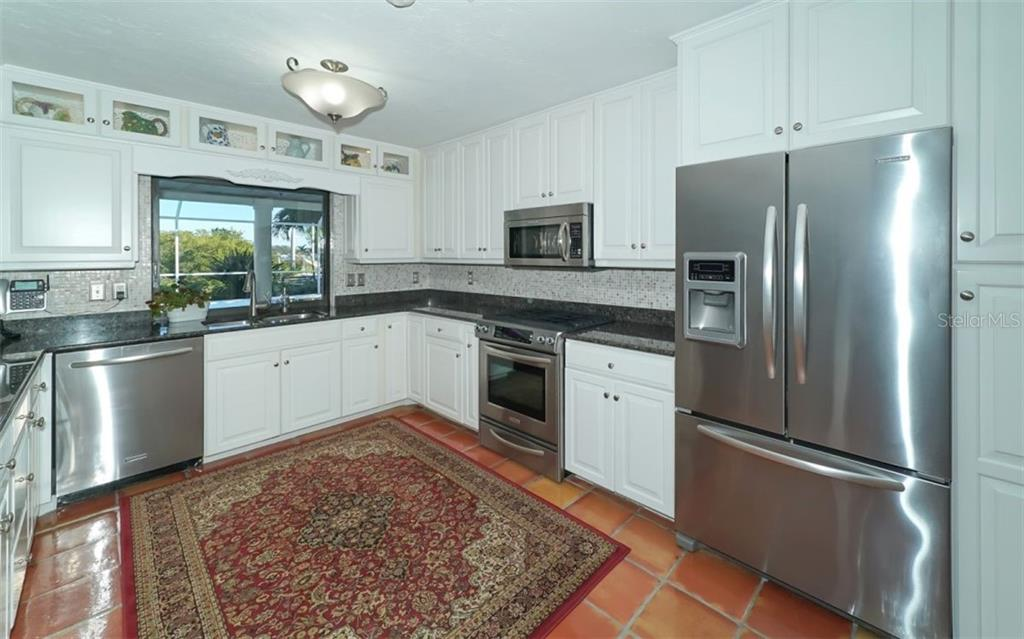Large kitchen with stainless steel appliances - Single Family Home for sale at 510 63rd St Nw, Bradenton, FL 34209 - MLS Number is A4424601