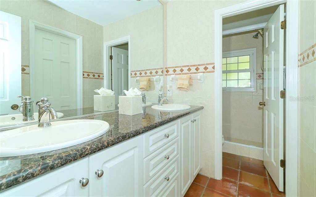 Bathroom # 2 with dual sinks and private shower/wc area - Single Family Home for sale at 510 63rd St Nw, Bradenton, FL 34209 - MLS Number is A4424601